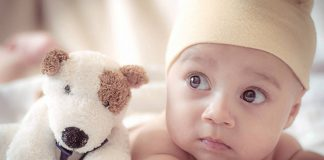 Adorable baby with toy dog