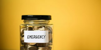 Emergency fund in jar against yellow background