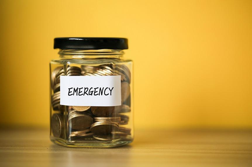 Emergency fund in jar against yellow background