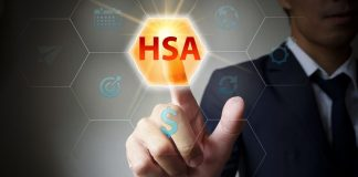 A man pointing to HSA button on digital screen