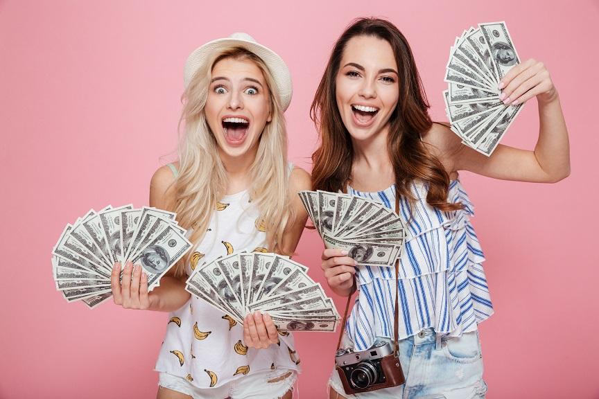 Two girls holding money