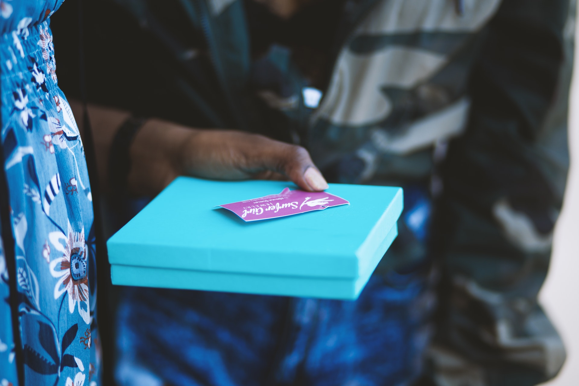 Woman-Holding-Gift-Card-Received-As-A-Present