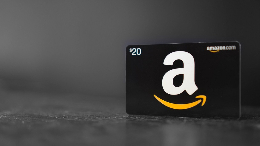 Amazon gift card standing upright on dark table