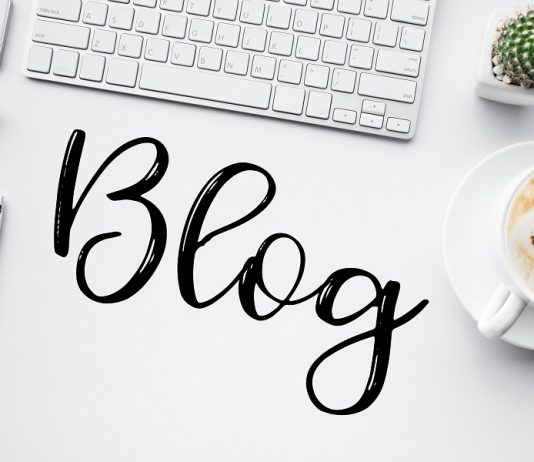 The word blog on top of a minimalist white desk