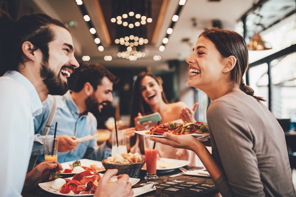 Group of people enjoying themselves at a restaurant