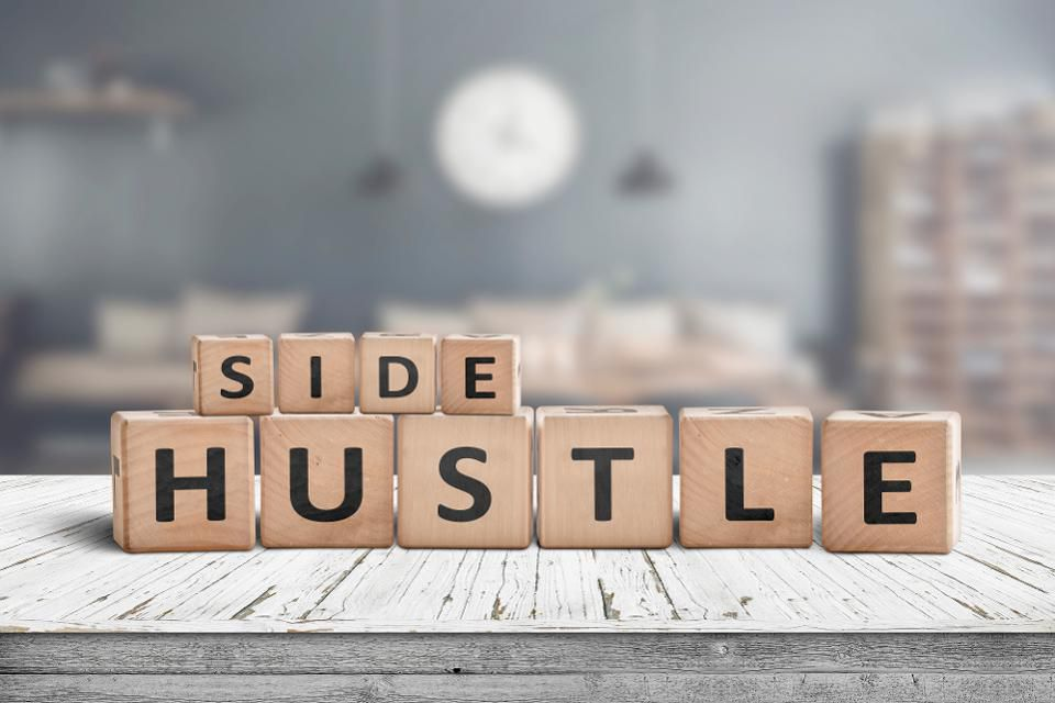 Side Hustle spelled out in crossword pieces
