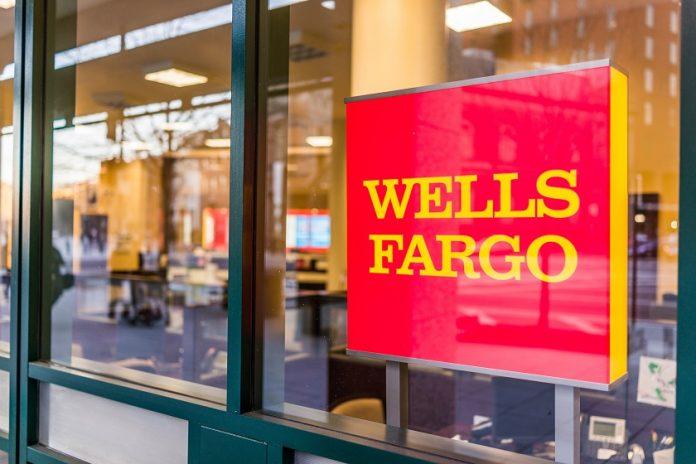 Wells Fargo window sign in front of bank