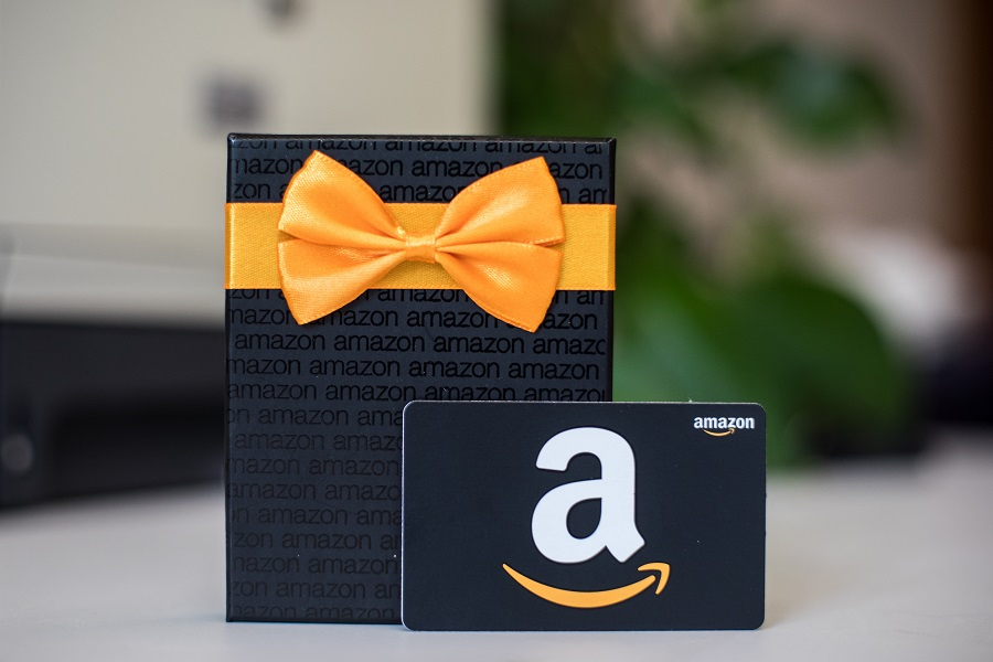 Amazon gift card and gift box standing upright