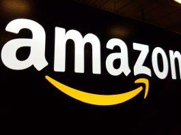 Amazon logo backlighting over black blackground