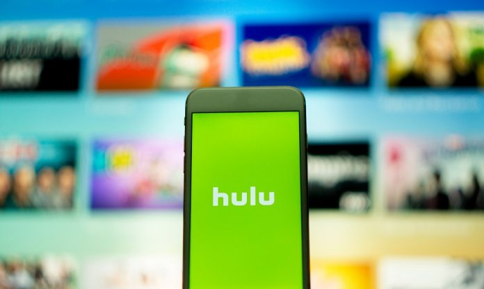 Hulu logo on phone with unfocused background