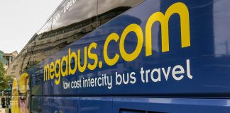Megabus name on the side of a Megabus bus