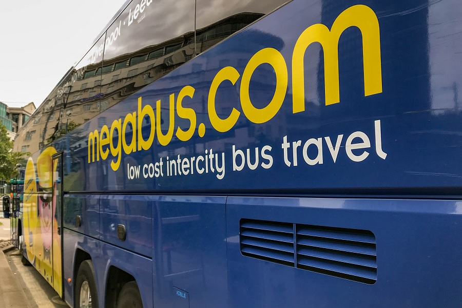 Megabus name on the side of a Megabus bus