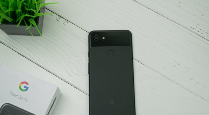 Google Pixel 3a XL phone on a white wooden background