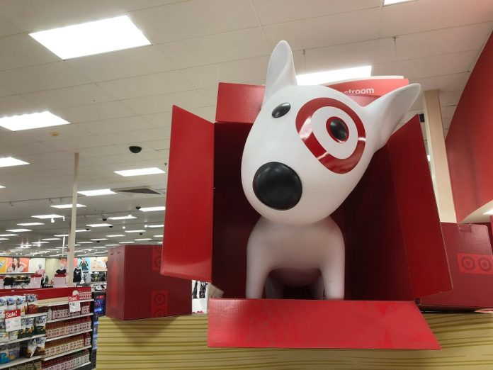 Target dog mascot popping out of a box in a store