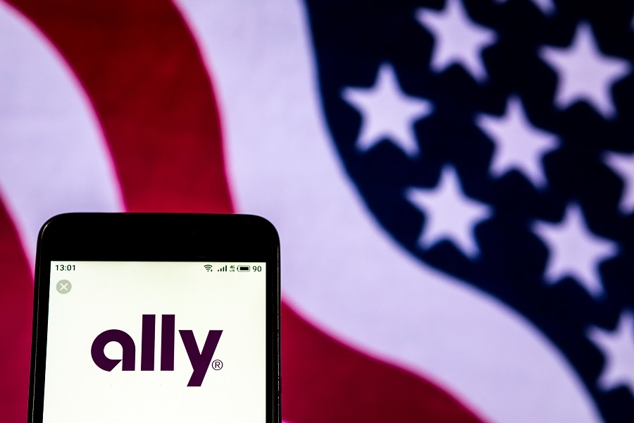Ally Bank logo on phone with American flag background