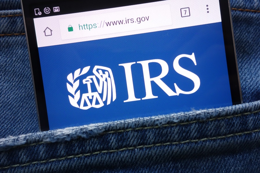 IRS logo on phone in a person's back pocket