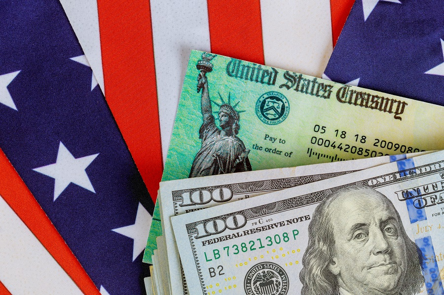 Treasure checks and money against US flag background