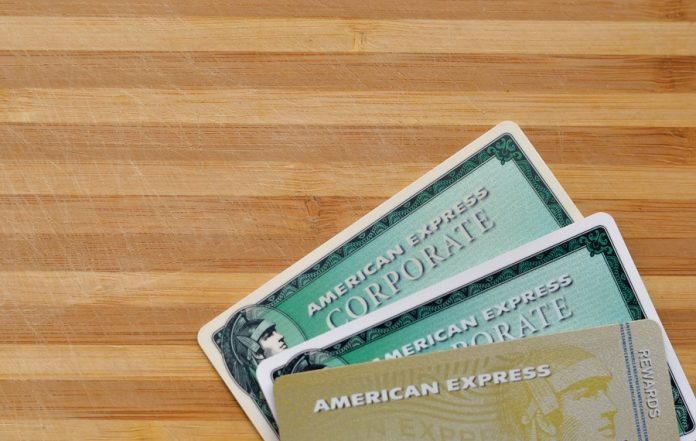 American Express Corporate cards on wooden table