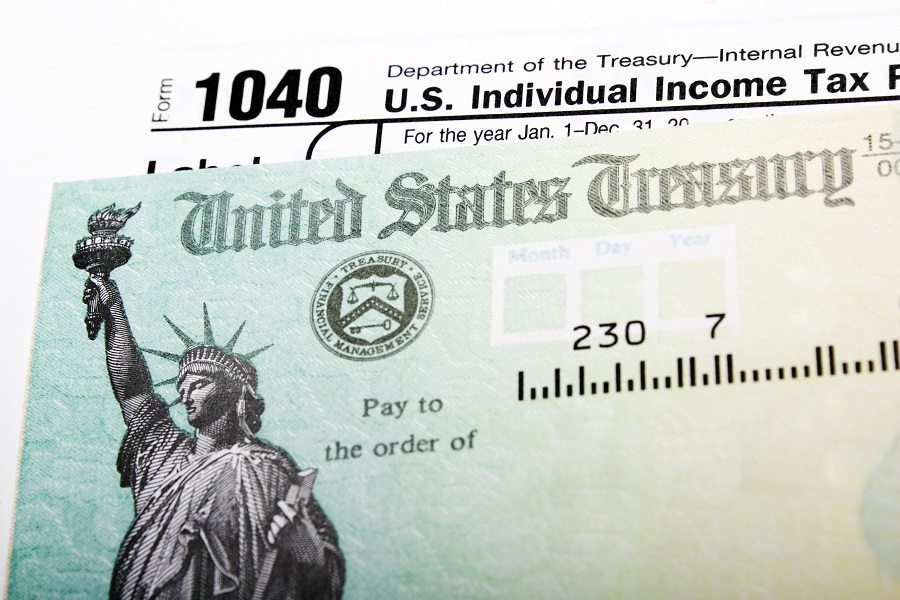 IRS check with 1040 form in the background