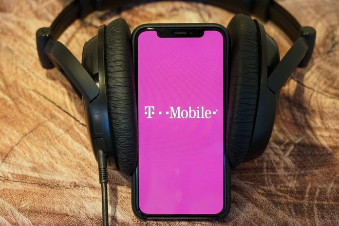 T-Mobile logo on phone that's wearing headphones