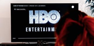 Woman viewing HBO logo on TV