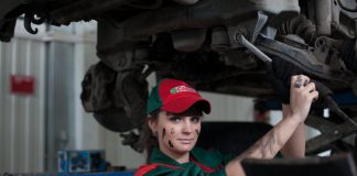 Oil change by woman with on face grease