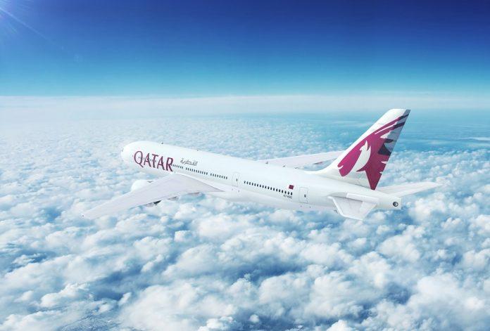 Qatar Airways flying over clouds