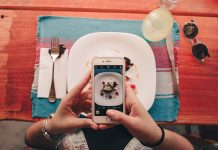Seated App Review Hero - taking a picture of food