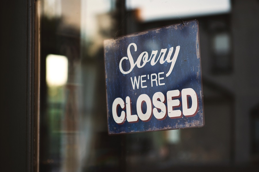"""""""Sorry we're closed"""" sign on window"""