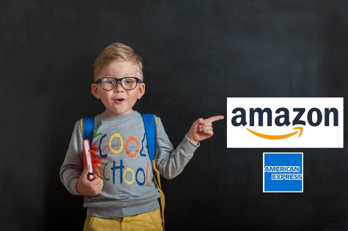 Ready for school boy pointing at Amazon logo on blackboard