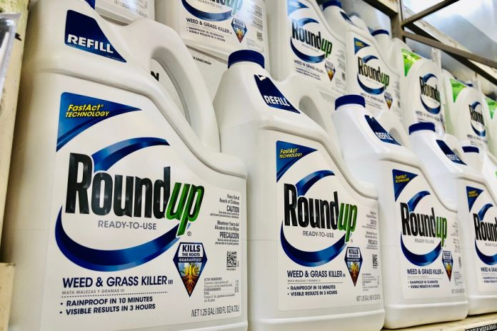 Roundup Weed Killer bottles on store shelf