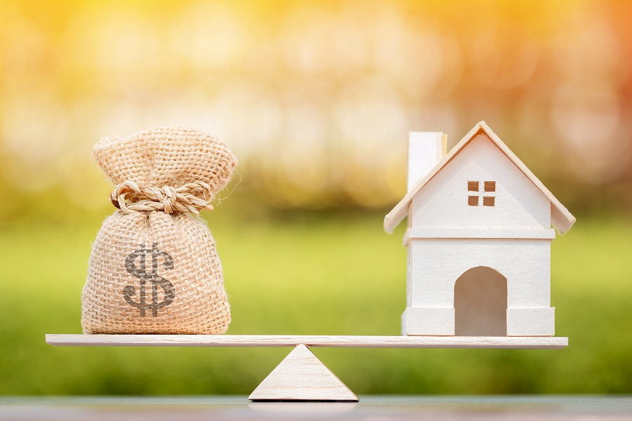 Balance scale depicting when should you refinance mortgage