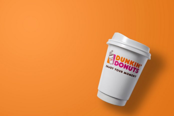 Dunkin' coffee over orange background