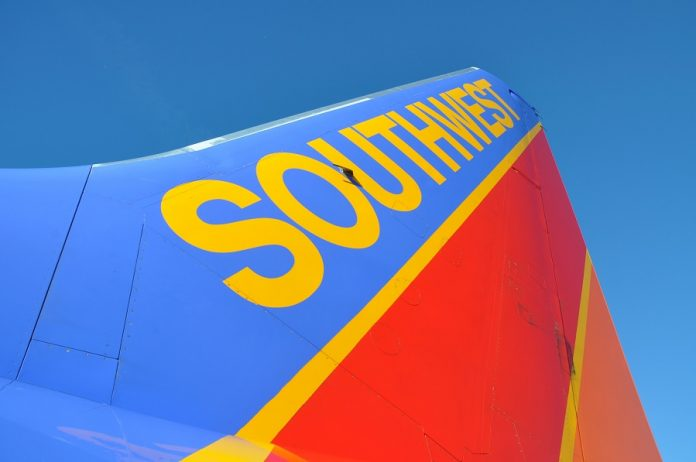Southwest Airlines logo on airplane wing