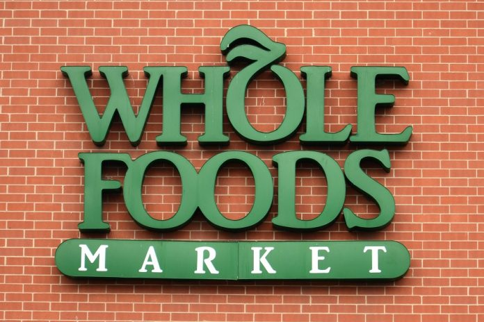 Whole Foods logo on brick building