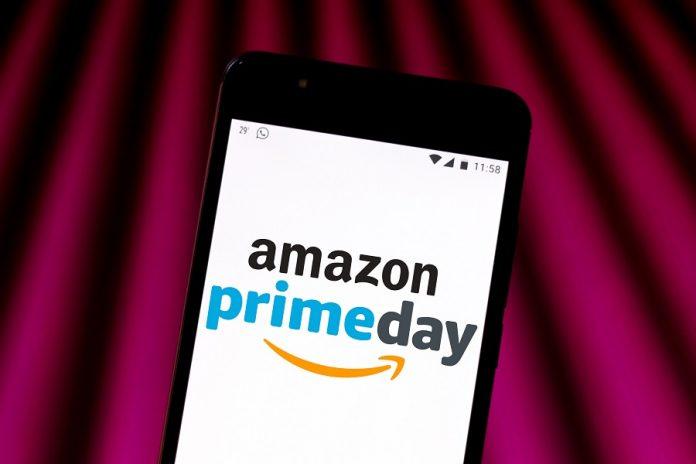 Amazon Prime Day logo on phone with purple beam background