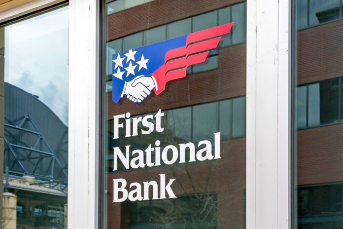 First National Bank logo on building
