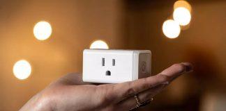 Kasa smart plug mini on woman's hand