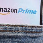 Amazon Prime logo on phone in back jeans pocket