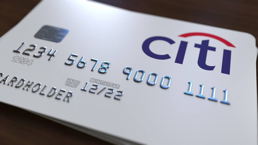 Citi card in white against wooden background