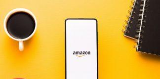 Phone with Amazon logo against yellow background