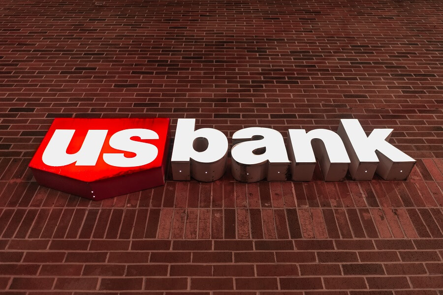 U.S. Bank logo sign on red brick wall