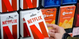 Gift card stand with Netflix gift card in foreground