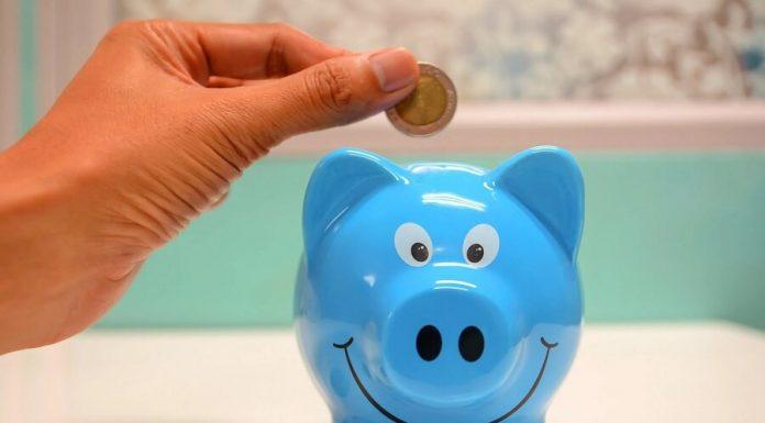 Saving money in blue piggy bank hero image