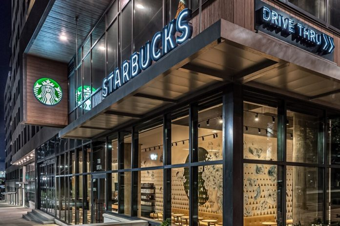 Starbucks cafe store front at night