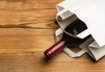 Bottle of wine in white bag hero image