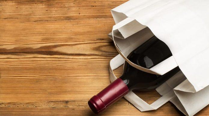Bottle of wine in white bag hero image