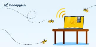 Honeygain bees flying towards laptop hero image