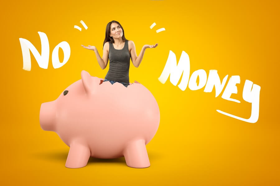 """""""No Money"""" words with woman in an empty piggy bank"""