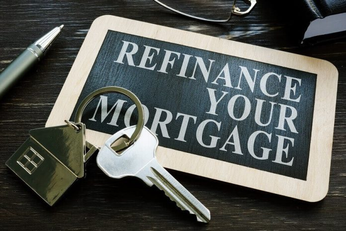 Refinance Your Mortgage phrase on keyholder